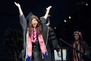 An informatics student celebrates at commencement